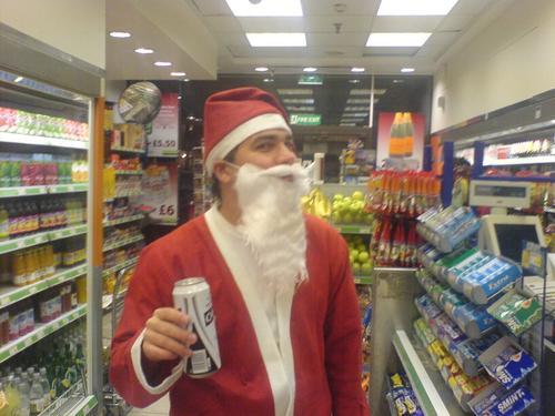 Papai Noel comprando umacerveja